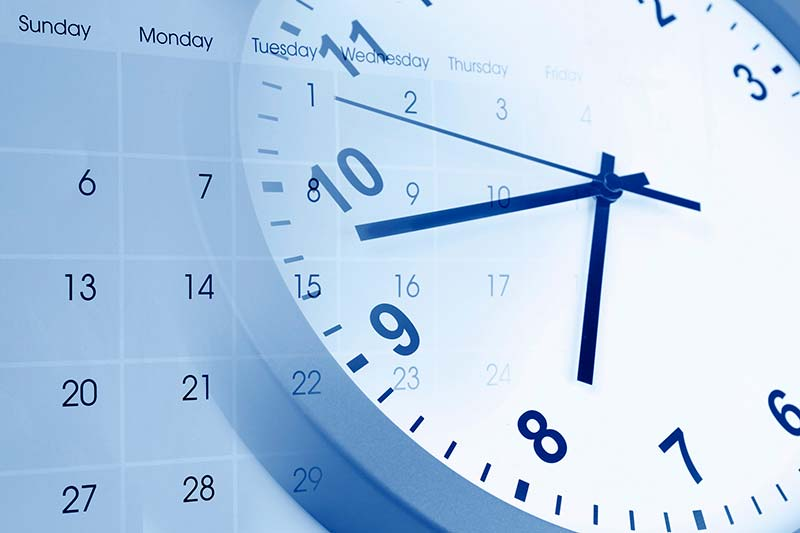 Clock and calendar overlap showing the passing of time in-between inspection services