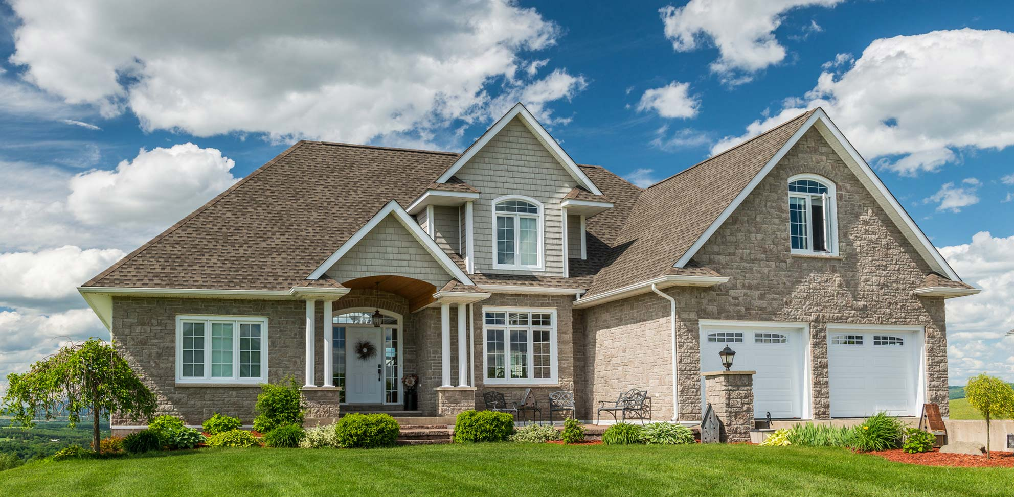 Beautiful family residential house on a hilltop seen while preforming a home inspection