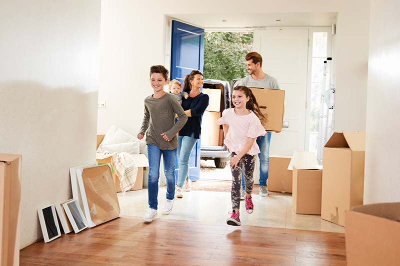 Family moving into their new house after it passed thorough home inspection services