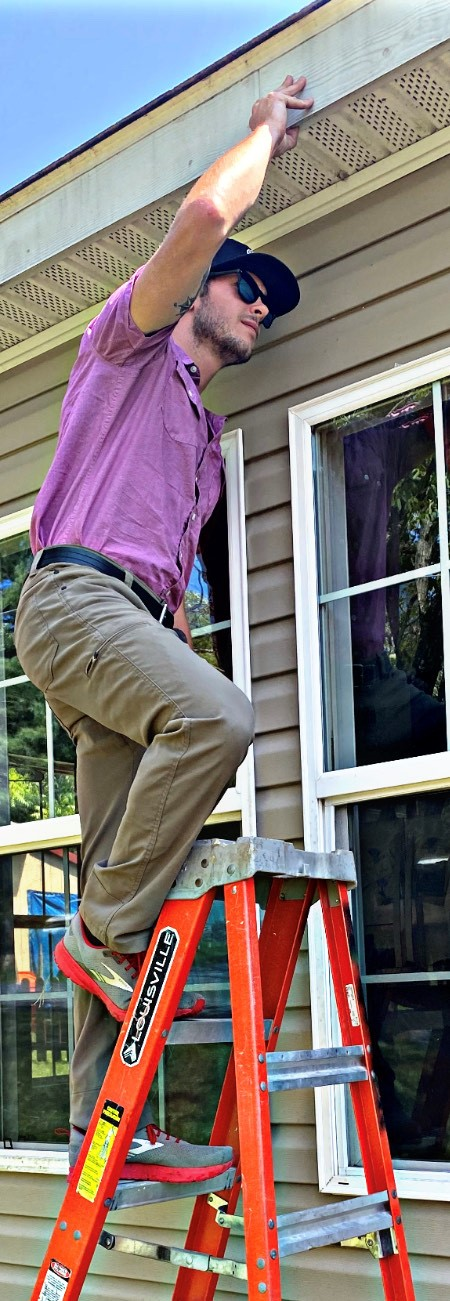 William, one of our certified home inspectors, on the roof go a house preforming an close inspection